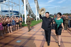 Kim Jong-un and wife: Kim Jong-Un waves to a crowd of swimmers