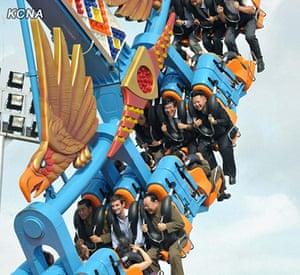 Kim Jong-un and wife: Kim Jong-Un smiles while enjoying a ride