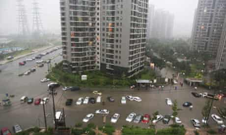 Cars submerged by Beijing storms 23/7/12