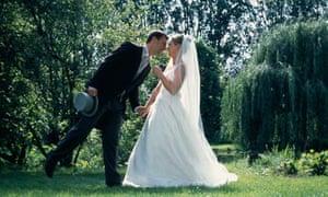 Bride and groom standing in garden
