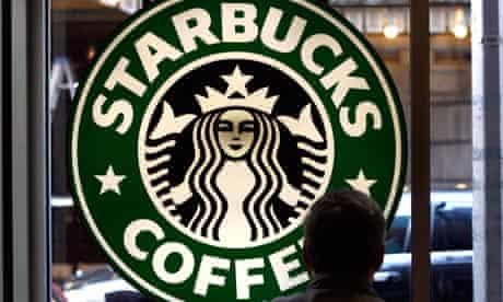 A customer sits in a Starbucks coffee shop