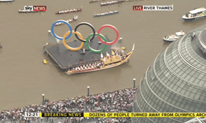 The Olympic flame by City Hall in London on 27 July 2012.