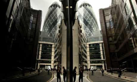 City workers smoke cigarettes in London's financial district