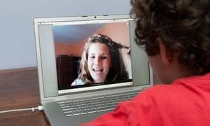Teenager talking on Skype on Apple laptop computer, England, Britain, UK