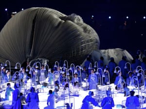 A giant model baby and nurses represent the NHS in a sequence during the London 2012 opening ceremony
