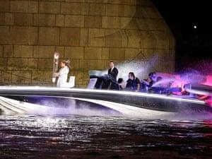 David Beckham passes under Tower Bridge