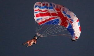 A performer playing the role of Britain's Queen Elizabeth parachutes from a helicopter during the opening ceremony of the London 2012 Olympic Games
