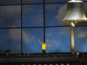 Bradley Wiggins waves to the crowd at the Olympic stadium after ringing a giant bell to officially start the London 2012 opening ceremony