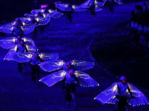Amazing scenes as performers with wings ride bikes