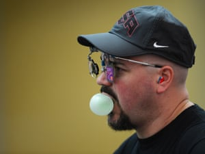 bubblegum being being blown by Jason Turner of the United States during the Men's 10m Air Pistol Shooting qualification