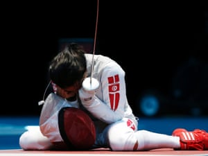 Tunisia's Ines Boubakri reacts to defeating France's Asrid Guyart during Womens Foil Individual Fencing