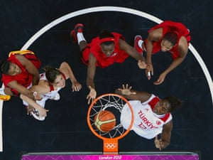 Nadir Manuel of Angola, centre, watches her shot in the basketball match against Turkey