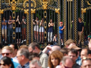 Fans hang on to the Canada Gates near Buckingham Palace for a better view of the conclusion to the men's road race
