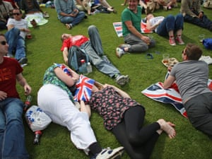 Members of the public relax in the Olympic Park on day one