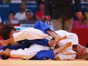 Eva Csernoviczki of Hungary is tangled up in the blue of Tomoko Fukumi of Japan