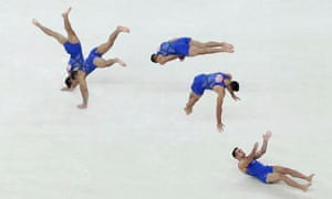 A multiple exposure photo shows U.S. gymnast Danell Leyva in action on the floor during the men's gymnastics qualification