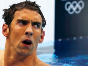 Michael Phelps of the U.S. reacts after finishing in fourth place in the men's 400m individual medley