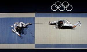 Italy's Elisa Di Francisca faces Korea's Nam Hyun Hee during a semifinal fencing match
