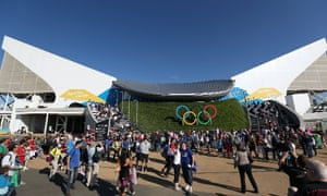 Fans make their way into the venue prior to the today's competition at the Aquatics Centre. Photograph: by Clive Rose/ Getty Images
