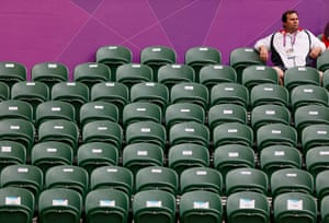 Olympics seating: A spectator sits amid empty seats during the women's singles match