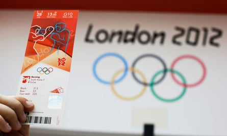 A fan holds up an Olympic ticket