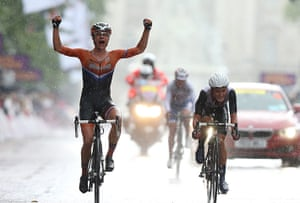 Women's road race: Marianne Vos of Netherlands celebrates as she crosses the finish line