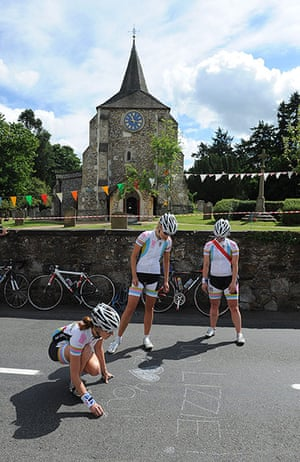 Women's road race: Cycling fans from London, chalk the name of Lizzie Armitstead on the road