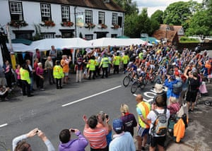 Women's road race: The peloton passes by the Running Horses pub in Mickleham village, Surrey