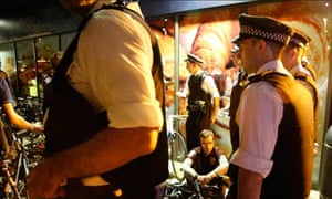 Police contain a group of protesting cyclists outside the London 2012 Olympics zone