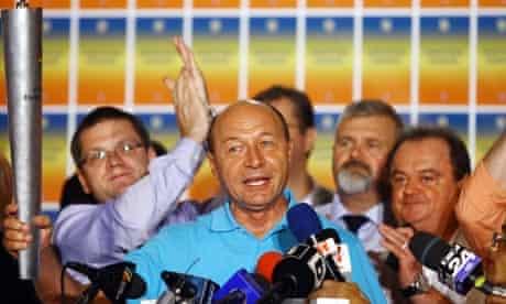 Romania's suspended President Traian Basescu celebrates