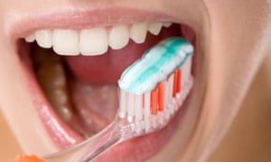 Young woman brushing her teeth, close up