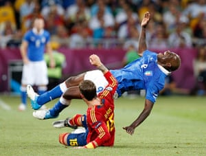 Euro picks: taly's Mario Balotelli after he is fouled by Spain's Sergio Ramos