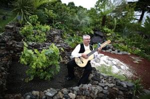 Hampton Court flower show: A musician plays in The Azorean Garden