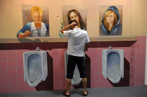 3D art China: People pose with a 3D painting exhibition in Hangzhou