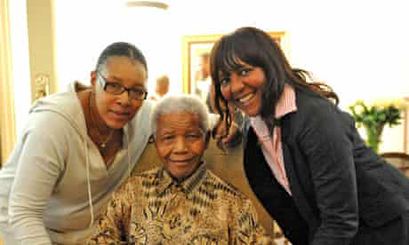 Nelson Mandela flanked by granddaughter Ndileka and daughter Zenani