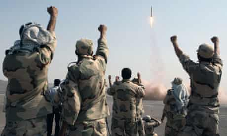Iran's Revolutionary Guard celebrate the successful test-fire of ballistic missiles