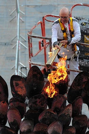 Olympic cauldron: Olympic Torchbearer Austin Playfoot lights the Olympic Cauldron