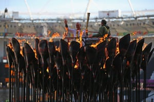 Olympic cauldron: The copper petals lit Olympic Flame is Repositioned