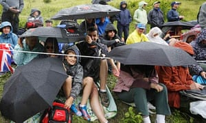 Olympics women's road race spectators shelter from rain at Box Hill