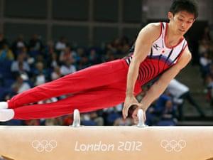 Kazuhito Tanaka of Japan competes on the pommel horse