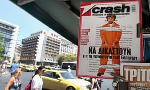 Angela Merkel iGreek magazine 'Crash' dressed as prisoner with handcuffs