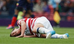 United States' Abby Wambach lays on the field after suffering from an injury at the hands of Colombia's Lady Andrade during the group G women's soccer match between the United States and Colombia at the London 2012 Summer Olympics, Saturday, July 28, 2012, at Hampden Park Stadium in Glasgow, Scotland. (AP Photo/Chris Clark) 2012 London Olympic Games;Summer Olympic games;Olympic games;Sports;Events;XXX Olympiad