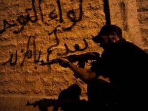 Syrian rebels patrol streets near Aleppo, Syria