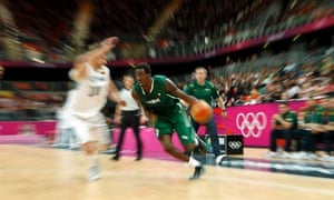 Nigeria's Al-Farouq Aminu (R) gets past Lithuania's Simas Jasaitis during their men's preliminary round Group A basketball match at the Basketball Arena