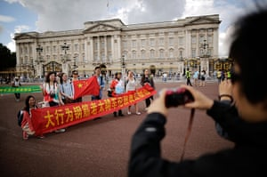 Quiet London: Chinese tourists have their pictures taken outside Buckingham Palace