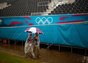 Quiet London: People walk past empty spectator stands