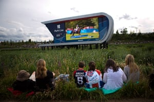 Quiet London: Spectators watch on a big screen television at the Olympic Park