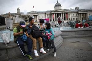 Quiet London: Tourists gather in Trafalgar Square