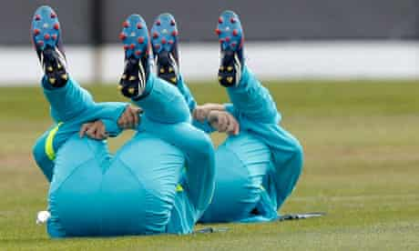 Players of Brazil's men's Olympic football team stretch during a training session in Manchester