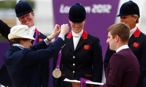 Zara Phillips receives her silver medal from her mother, Princess Anne, during the Eventing Team Jumping equestrian event victory ceremony